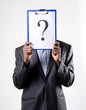 businessman holding a question mark