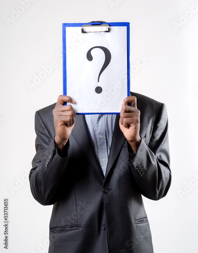 businessman holding a question mark