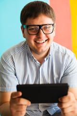 man uses a digital tablet