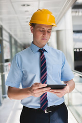 engineer in a helmet with a digital tablet