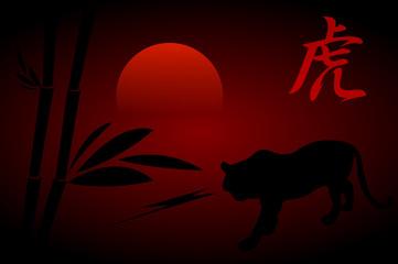 black tiger on red background sunset