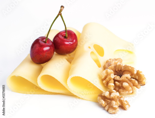Leerdammer cheese slices with nuts and cherries on white base