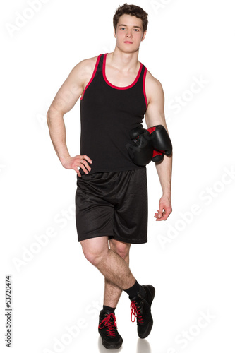 Full length of boxer standing with gloves under his hand