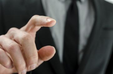 Business man touching virtual screen