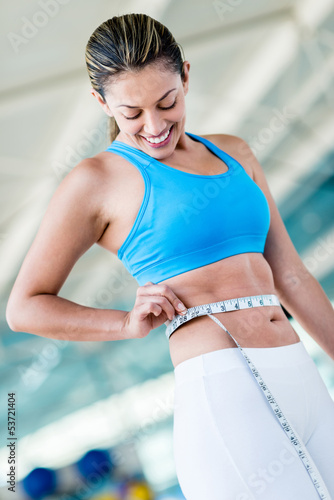 Gym woman taking measurements