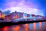 Dublin Ireland at dusk with waterfront and Ha'penny Bridge