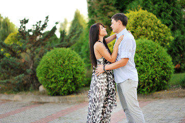 Young happy couple in love - outdoor portrait