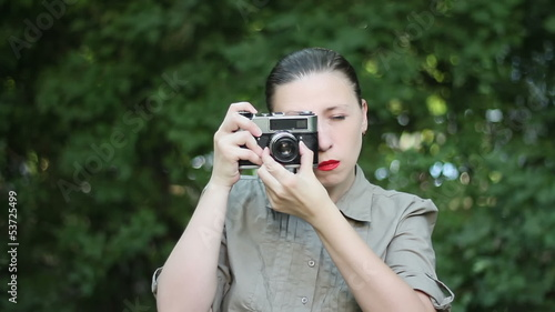 Woman with an old camera
