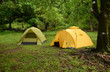 two tents on lush green campground