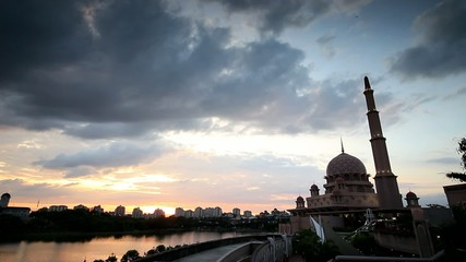 Sunset and clouds moving over putrajaya mosque