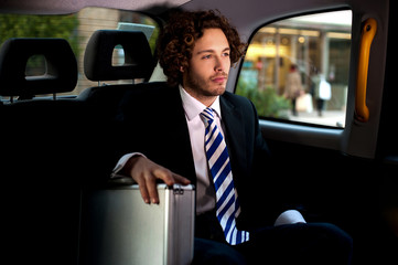 Handsome businessman inside taxi cab