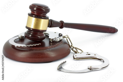 Wooden gavel and handcuffs