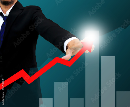 Businessman drawing a rising arrow . business growth Concept.