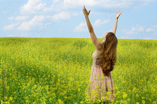 Young woman at canola field