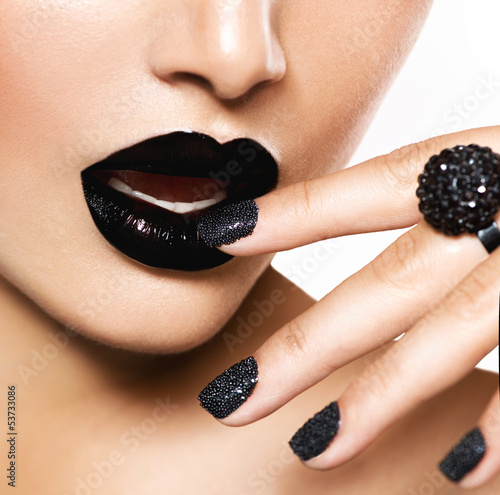 Trendy Black Caviar Manicure and Black Lips. Fashion Makeup