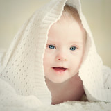 baby with Down syndrome hid under blanket