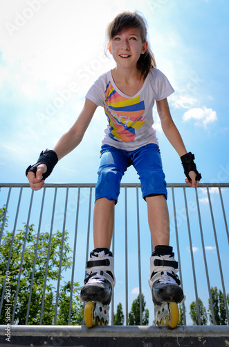 Young girl rollerskating