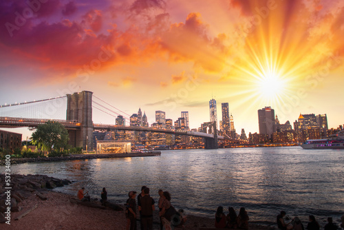 New York City. Wonderful sunset view of Brooklyn Bridge and Manh