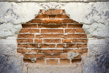 destroyed wall with a brick