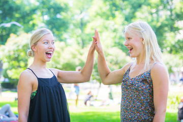 Two Beautiful Blonde Girl giving High Five