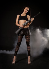 Athletic girl with a gun