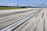 Concrete runway of Split airport with traces of airplane wheels