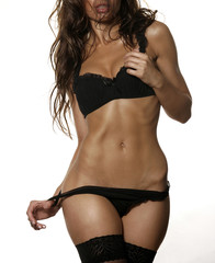 Woman semi nude body in underwear and black stockings