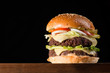 big burger isolated on black