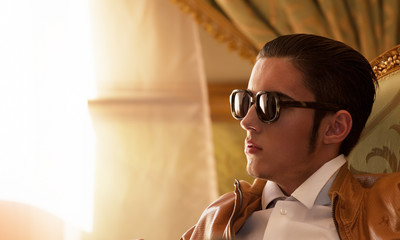 Closeup portrait of young brunet man in sunglasses