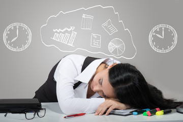 Woman sleeping on her workplace, drawn clocks over her head