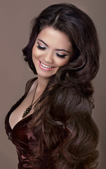 Hair. Fashion style. Happy Smiling Brunette Girl. Healthy Long H