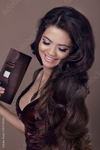 Fashion girl model, brunette woman with shiny curly silky hair i