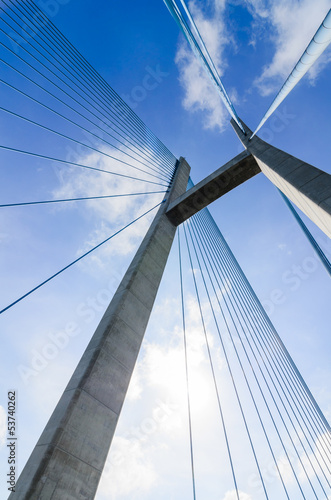 The top of the cable-stayed bridge in the cloud blue sky