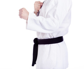 Black belt man practicing martial arts, isolated on white