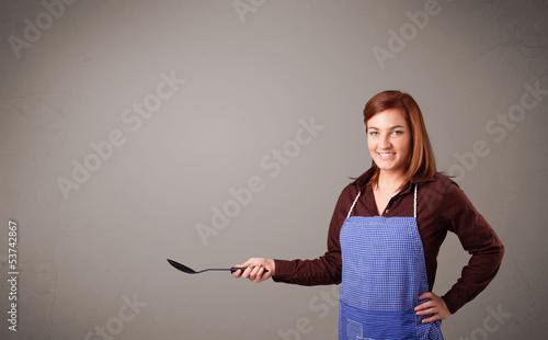 Pretty woman holding a spoon