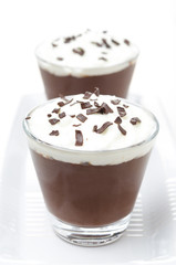 chocolate mousse with whipped cream on white background