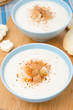 cold cauliflower soup with croutons and cheese, close-up
