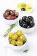 three kinds of olives, fresh rosemary and olive oil
