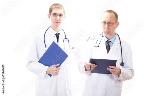 Young medical doctor cheering depressive doctor up