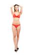 Full length woman in bikini isolated on white