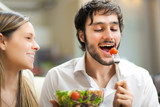 Lovely couple eating a salad