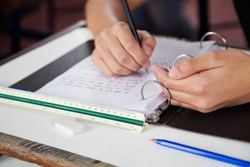 Schoolboy Copying At Desk During Examination