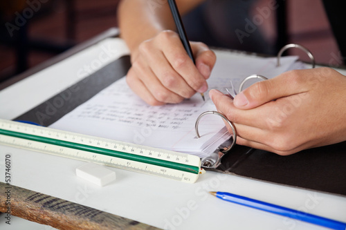 Schoolboy Copying At Desk During Examination