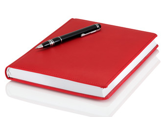 Leather notebook and pen isolated on the white