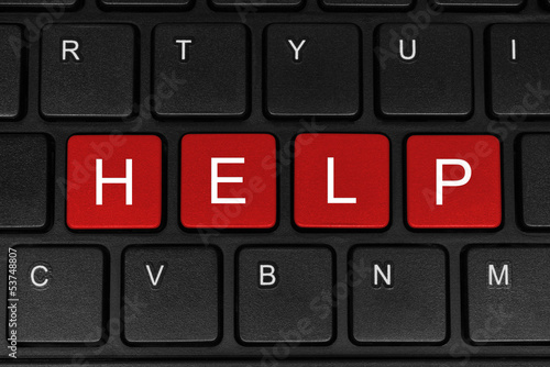 The word help made of four red buttons