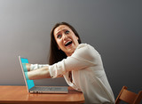 internet absorbing shocked woman