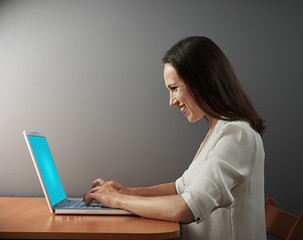 excited woman working with laptop