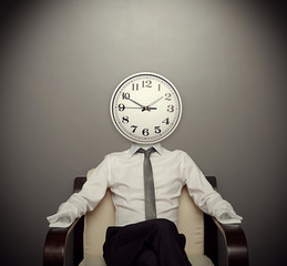 man with a clock instead of a head