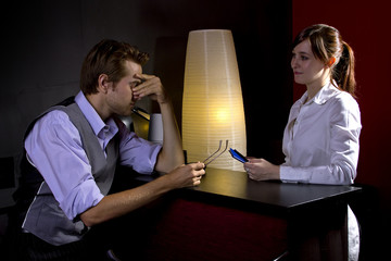 young businessman ordering coffee from female waitress