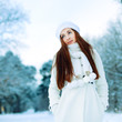 Young beautiful woman in the snow